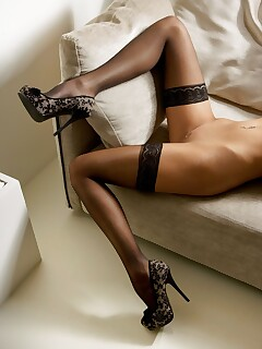 Elegant lady in black stockings Rosanne Jongenelen having a solo scene at home