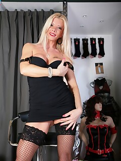 Blonde MILF strips off her black dress to play with herself