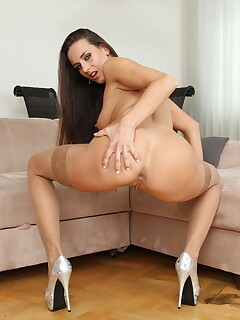 Mea Melone is stretching her ass on a big black dildo