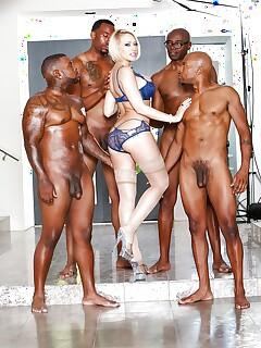 Blonde Kagney Lynn Karter strutting in lingerie before interracial gangbang