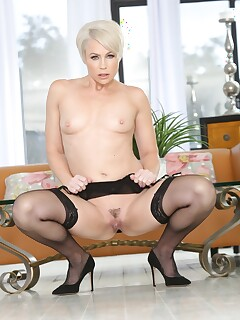 Short haired mature shows small boobs in sexy garter and stockings