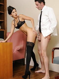 Classy lady Nikki Daniels gets banged over her office desk in black stockings