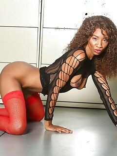 Black chick takes an external cumshot after sex in red hosiery