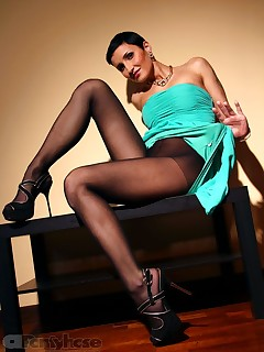 aPantyhose - Flexible short-haired bitch in black pantyhose on long sexy legs