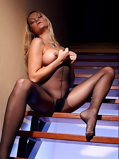aPantyhose - Leggy blonde whore teases in sexy black pantyhose