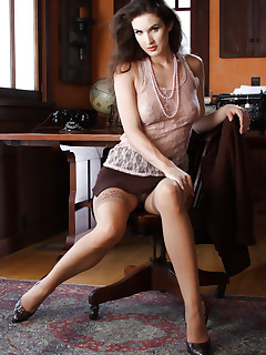 Adorable secretary in stockings